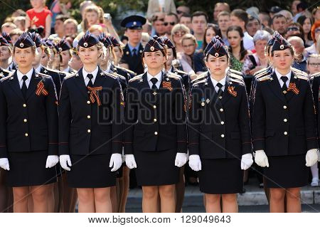 Orel Russia - May 9 2016: Celebration of 71th anniversary of the Victory Day (WWII). Girls in russian military uniform standing in row horizontal