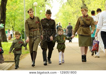 Orel Russia - May 9 2016: Celebration of 71th anniversary of the Victory Day (WWII). Family in soviet military uniform horizontal