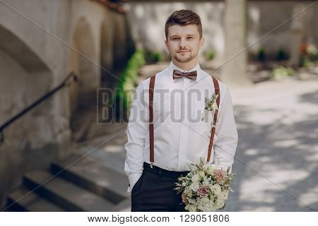 the image of the groom shirt and suspenders wedding bouquet