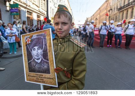 St.PETERSBURG, RUSSIA - MAY 9, 2016: Participants of Immortal Regiment - public action, during which participants carried banners/portraits of their relatives who participated in Great Patriotic War.