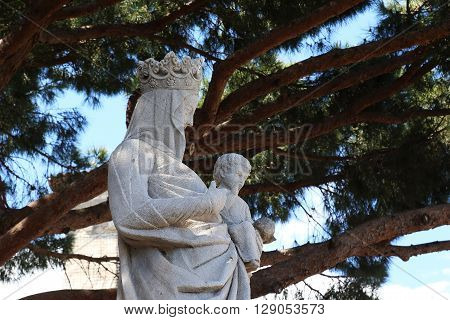 Cannes, France - May 22: It is a sculpture of Our Lady with Jesus near the Church of Our Lady of Hope May 22, 2015 in Cannes, France.