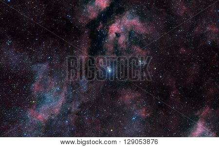 Deep space background filled with bright nebulae and shining stars.