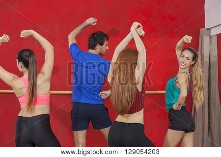 Woman Doing Zumba With Friends In Gym