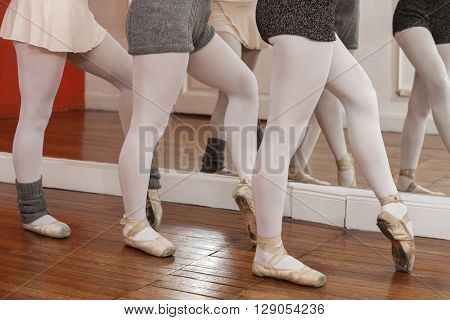 Low Section Of Ballerinas Performing Pointe