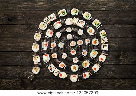Japanese food restaurant, sushi maki roll plate or platter set. Maki Sushi rolls at rustic wood background. Top view, flat lay. Big party sushi set.