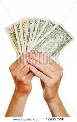 Two hands holding dollar money bills as a fan