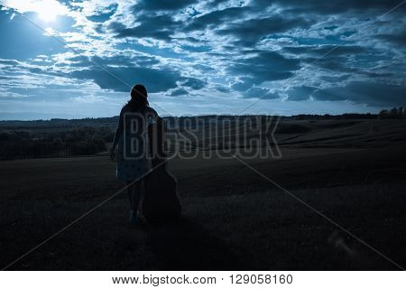 Country Girl With Guitar At Field