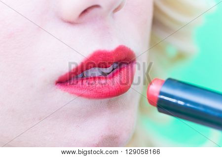 Lips with lipstick makeup for the face.