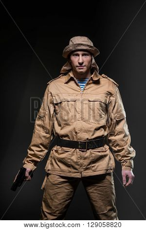 Military war conflict soldiers - Special forces soldier with a gun on dark background