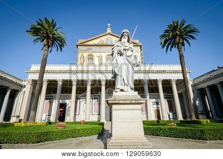 beautiful cloister in Saint Paolo (paul) in Italy Rome statue church and palms in background