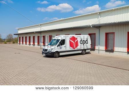ALTENTREPTOW / GERMANY - MAY 5 2016: a german mercedes benz van from dpd stands on logistic depot in altentreptow / germany on may 5 2016.