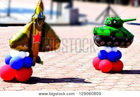 Helium balloons, toy,airplane, yellow, red star, holiday decoration, design , green, red balls, blue balls, May 9 holiday