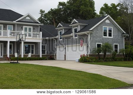 House exterior with driveway and American flag