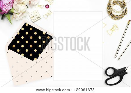 Feminine scene. Glamour style. Gold and stationery items on white table. View up. Flat lay. Wedding template invitation. Place your text or your artworks. bouquet of flowers, peonies with the tulips.