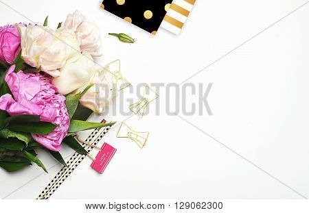 Peonies and gold. Office desktop. Flat lay. Glamour style. Stationery on white background