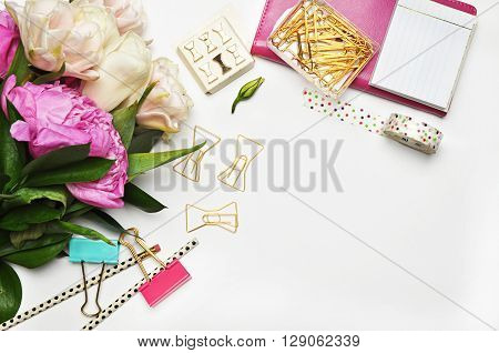 Flat lay. Flower on the table. Table view.Mock-up background. Peonies and stationery