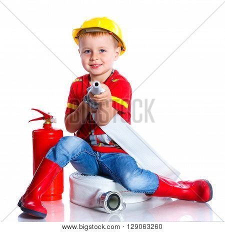 Expressive cute toddler boy with fireman's outfit on. Isolated on the white background