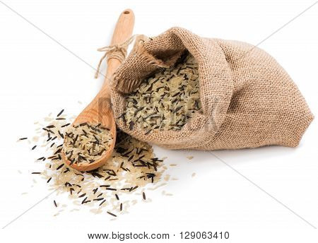 Raw black and white rice grains in burlap bag isolated on white background.