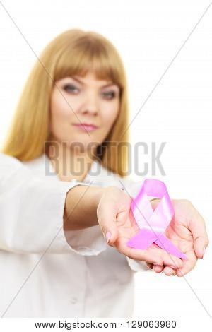 Healthcare medicine and breast cancer awareness concept. Doctor showing pink ribbon aids symbol