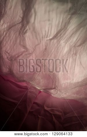 Beautiful white transparent wave tissue gauze textured fabric on pink material abstract background