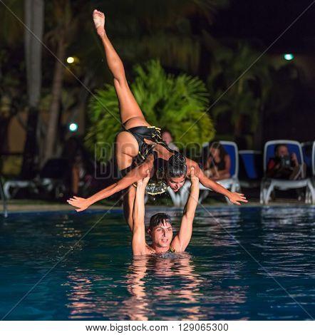 Varadero island, Roc arenas dorados resort, Cuba, Aug. 10, 2014,gorgeous amazing view of professional Cuban dancers, performers doing their beautiful job at night show in swimming pool.