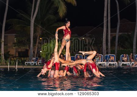 Varadero island, Rock Arenas Dora-dos, Cuba, Aug 10, 2014, Amazing beautiful stylish water show performed by a high passionate professional Cuban dancers at night swimming pool