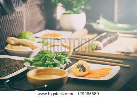 sushi roll process of making raw makki fresh seafood susi - stock image