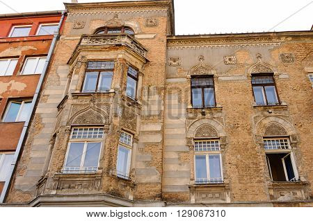 SARAJEVO BOSNIA AND HERZEGOVINA - SEPTEMBER 4 2009: Neglected facade of a building in Moorish revival architectural style