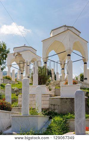 SARAJEVO BOSNIA AND HERZEGOVINA - SEPTEMBER 4 2009: Two white Ottoman turbe in the Alifakovac cemetery