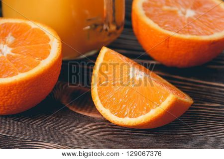 Orange, Half of Orange, Orange Lobule on the Wooden Table. Healthy Lifestyle Concept