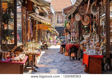SARAJEVO BOSNIA AND HERZEGOVINA - SEPTEMBER 4 2009: Street with shops selling souvenirs at Bascarsija in the old city district