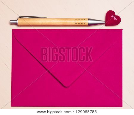 Pink Envelope Heart And Pen On Table