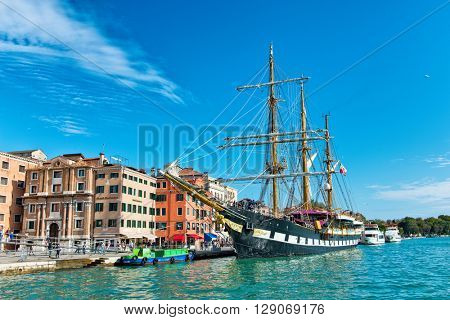 VENICE, ITALY - 17 OCTOBER 2015: The three masted Palinuro, a historic Italian Navy training barquentine, moored in the Giudecca Canal, Venice, Italy alongside the Riva. October 17 2015.