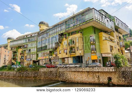 SARAJEVO BOSNIA AND HERZEGOVINA - SEPTEMBER 4 2009: The Parrot building so called due to its colors and eccentric architecture