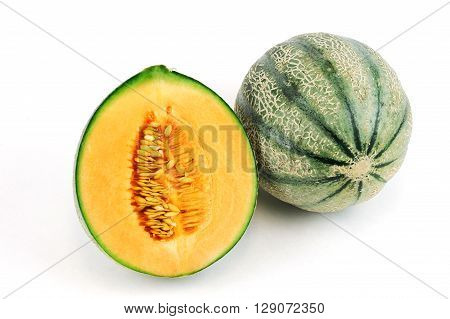 fresh cantaloupe melon on white background, with one cut in half