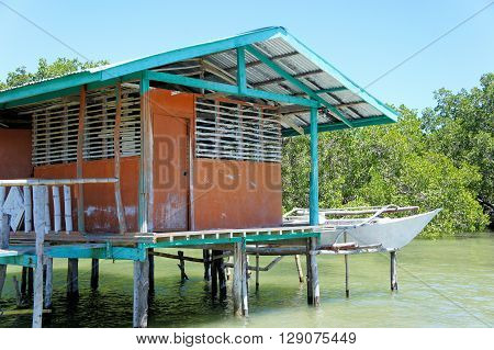Traditional fisherman's house on stilts in the sea. Philippines.