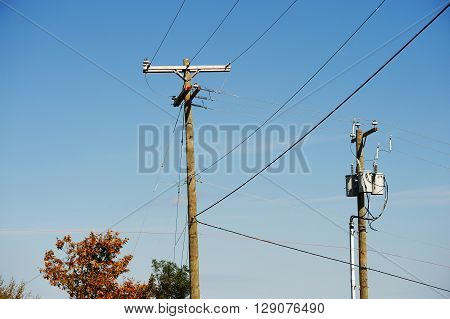 power pole and power lines against sky