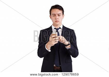 Young Caucasian Business Man Frowning Looking At Mobile Phone