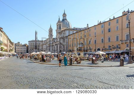 Rome Italy - August 22 2015: the famous Navona square in Rome with people walking in a hot day of august