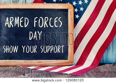 the text armed forces day, show your support written in a chalkboard and a flag of the United States, on a rustic wooden background