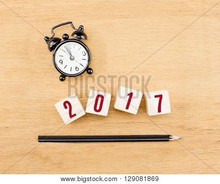 2017 Year On Wood Cube With Pencil And Clock Top View On Wood Table,new Year Business Concept