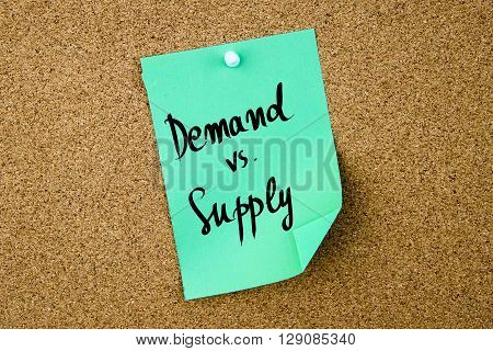 Demand Versus Supply Written On Green Paper Note