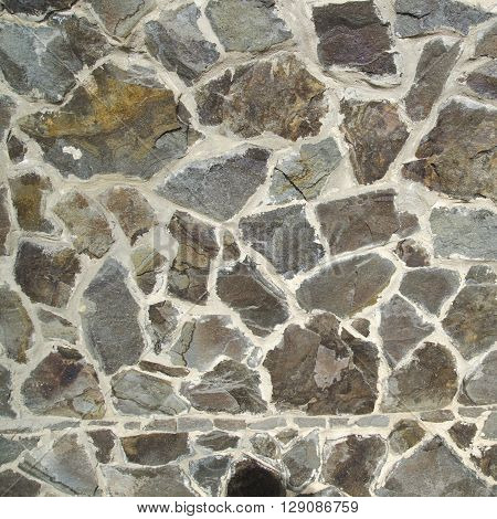 Stone texture made of different stones. Realistic texture photo