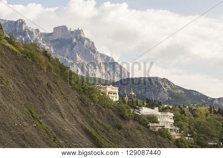 background landscape view of the Alupka, churches and villas, amid mountains Ai-Petri in Crimea