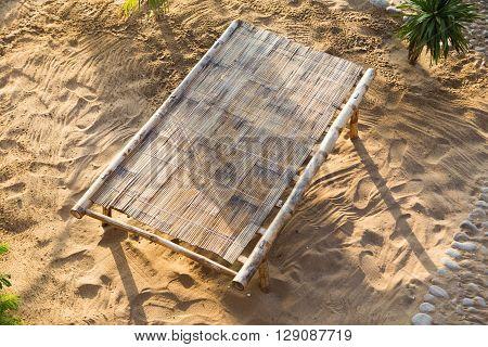 Bamboo sun bed on a tropical beach resort