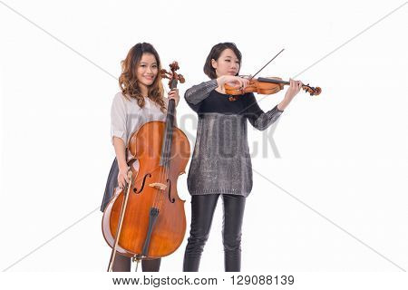 Two young woman is playing the violin