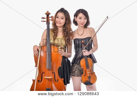 Portrait of young two woman with violin in studio