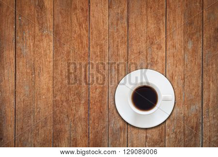 Top view of white coffee cup on wooden background, stock photo
