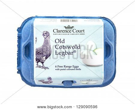 SWINDON UK - APRIL 17 2016: Box of Clarence Court Old Cotswold Legbar Free Range eggs with pastel coloured shells on white background