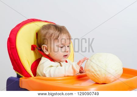 Baby Sits In Highchair
